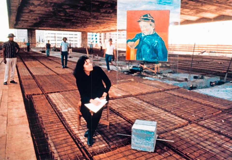 Lina Bo Bardi next to one of her cavaletes on the museum construction site. From Domus 999, February 2016