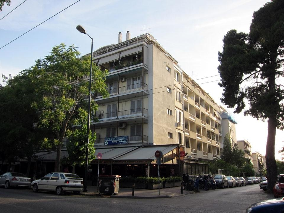A recent image of Chara, the largest housing block in downtown Athens. It is also one of the few <i>polykatoikies</i> with a habitable courtyard, a little garden and a playground.
