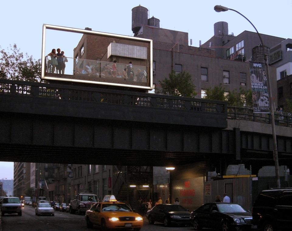The 26th Street Viewing Spur as seen from the street. A large glowing frame at the edge of the platform simultaneously evokes a billboard, and a proscenium arch, a picture window, a camera viewfinder. © Gideon Fink Shapiro.