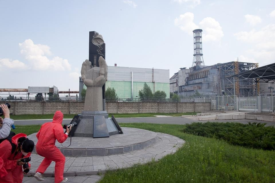 The rush to take pictures of Chernobyl's Reactor 4 sarcophagus in under two minutes. Photograph by Neil Berrett.