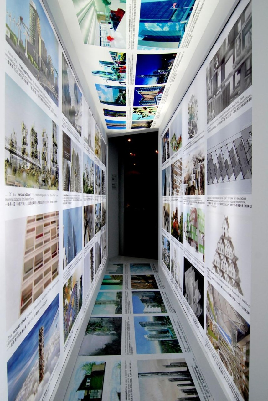 "Visitors are led through a glowing tunnel, lined with images harvested from a Google image search of the term ""vertical village"""