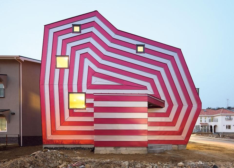 "Top: In the dreamlike scene of <em>Illustrated Diary ""Ring Ring""</em>, iconic figures coexist in a world free of functional and physical constraints. Above: Lollipop House (2012). In place of the usual typological repetition, Moon dialogued with the clients to make a new type of architecture with pop and erotic implications. Photo by Namgoong Sun"
