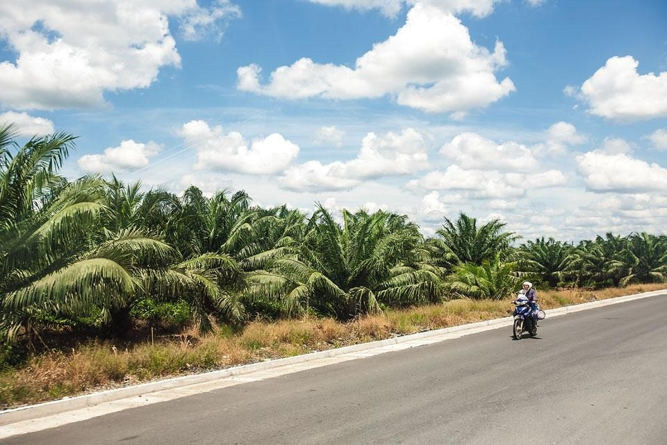 A worker travelling along