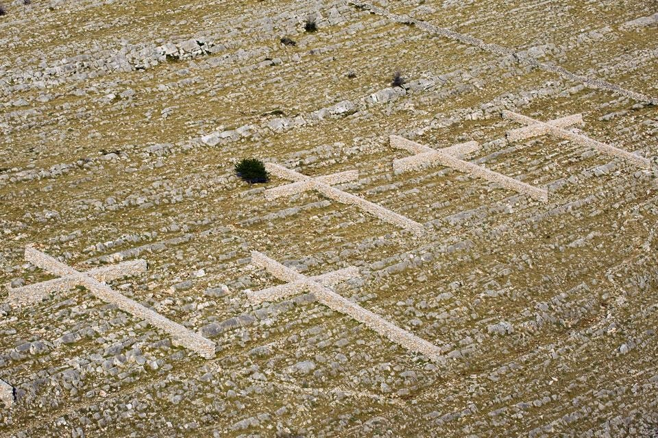 Top and above: Nikola Bašic, <em>Field of Crosses</em>, Fallen Firemen Memorial, Kornati National Park, Kornat island, 2010