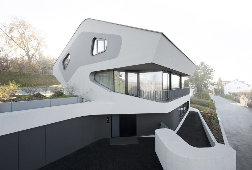 Amidst A Residential Complex In Stuttgart The German Studios Latest House Features Organic Sculptural Lines Fully Expressed An Exuberant Staircase