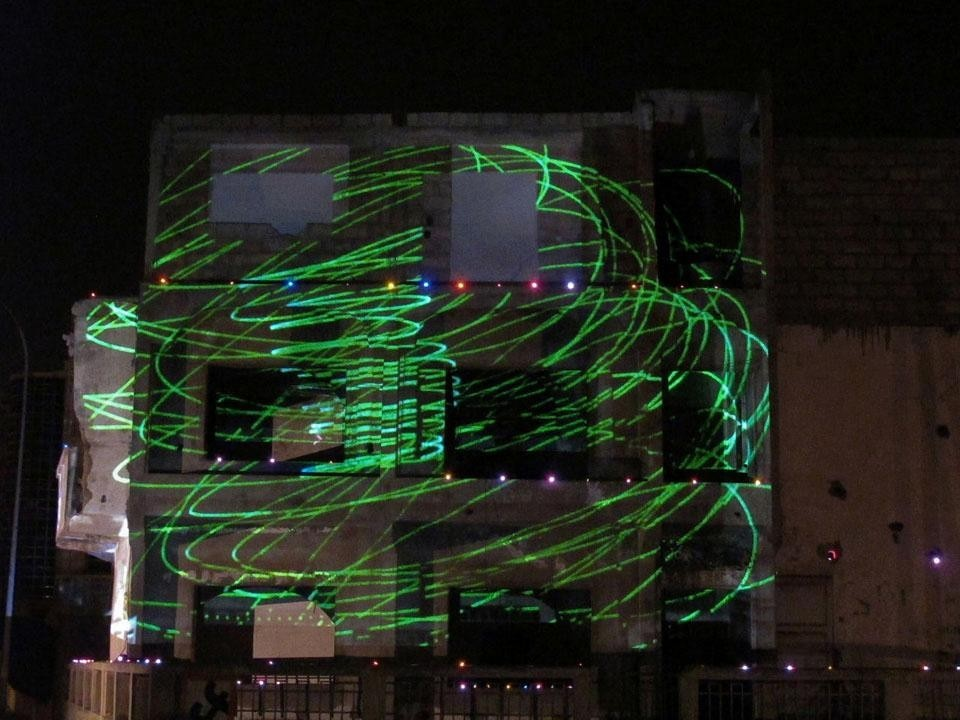 Laser images projected on Maison 46 in Zone A of Dakar. The building – abandoned for 10 years – is destined for demolition. The projections underline the decrepit state of the building and, with drawings and new images, prefigure its future.