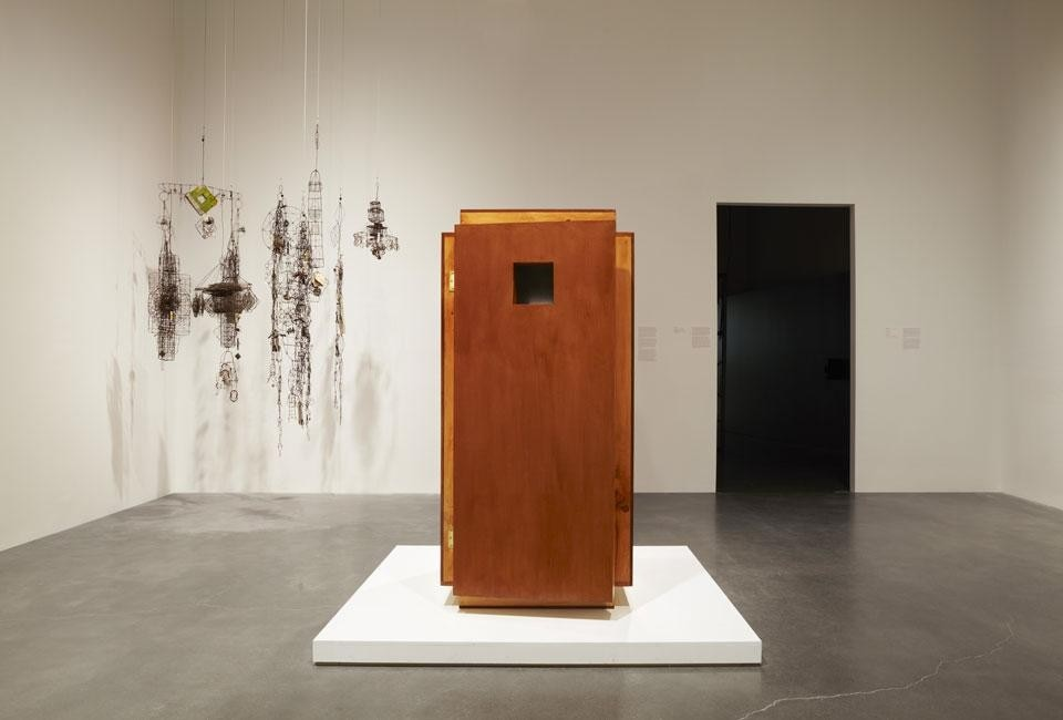 In the background, Emery Blagdon, <em>Untitled,</em> ca. 1955—86. In the foreground, <em>Orgone Energy Accumulator</em>, 2012, invented by Wilhelm Reich in 1940