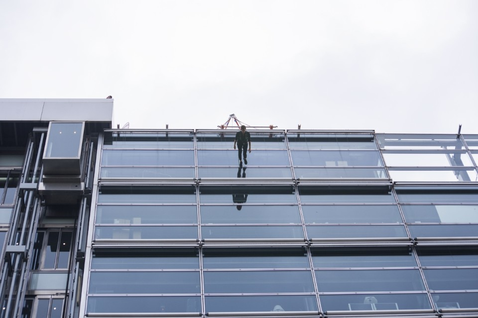 Man walking down the side of a building