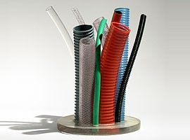 Plastic and rubber cables of various sizes go to make up a vase for flowers. Design by Thais Stoklos and Leonardo Ceolin, 2002