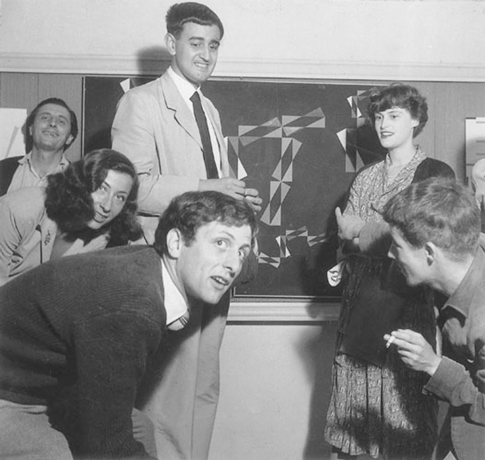 "A young Maldonado (1949) together with Max and Gianni Dova in front of the painting ""Black-Woogie"" by Huber.  The painting is the source of the wall decoration for the Sirenella (1949) jazz club designed by Huber"