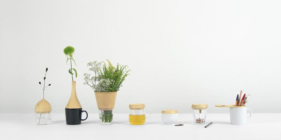 "Daisuke Kitagawa's  Rename—seven wooden accessories that thanks to a silicon ring, interchange with ""extensions"" that fit all the most common mug formats, inventing new uses: flower vase, pencil sharpener, pen holder, sugar bowl, money box, jug, etc."