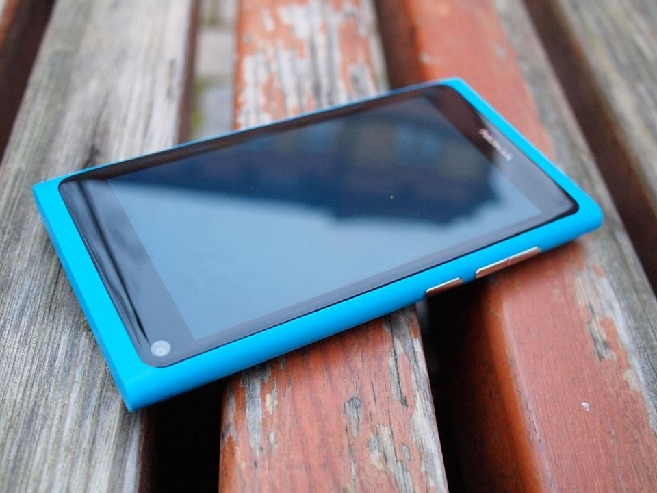 The N9 is designed to have no 'home button', but instead one simply swipes through three primary modes.