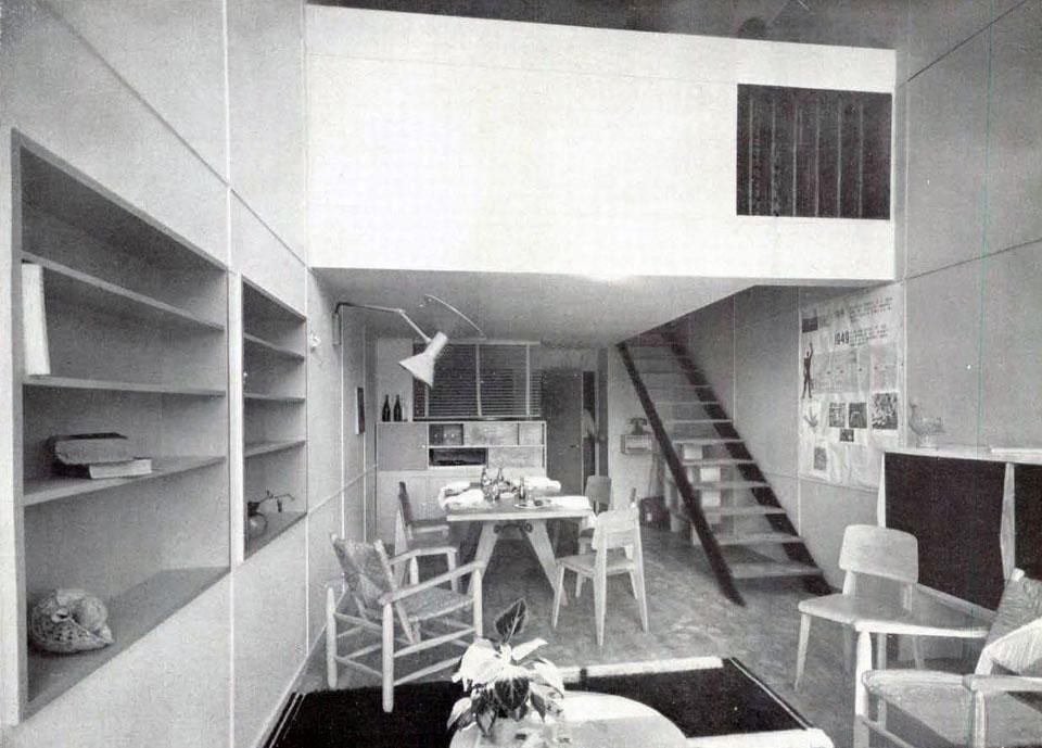 The living room of a typical dwelling unit; the interior staircase leads to the bedrooms.