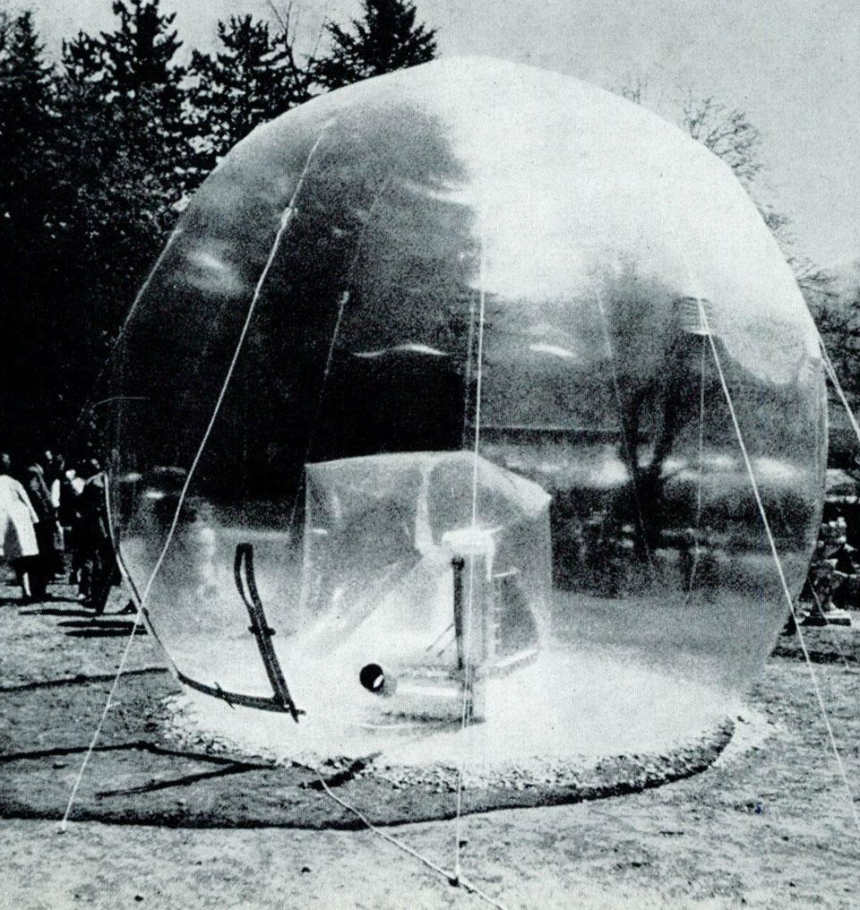 By Walter Pichler, architect and designer in Vienna, a transparent inflatable sculpture (<i>Grosser Raum</i>, 1966) shown in a transparent sphere, in Kapfenberg Park, Austria, in the spring.