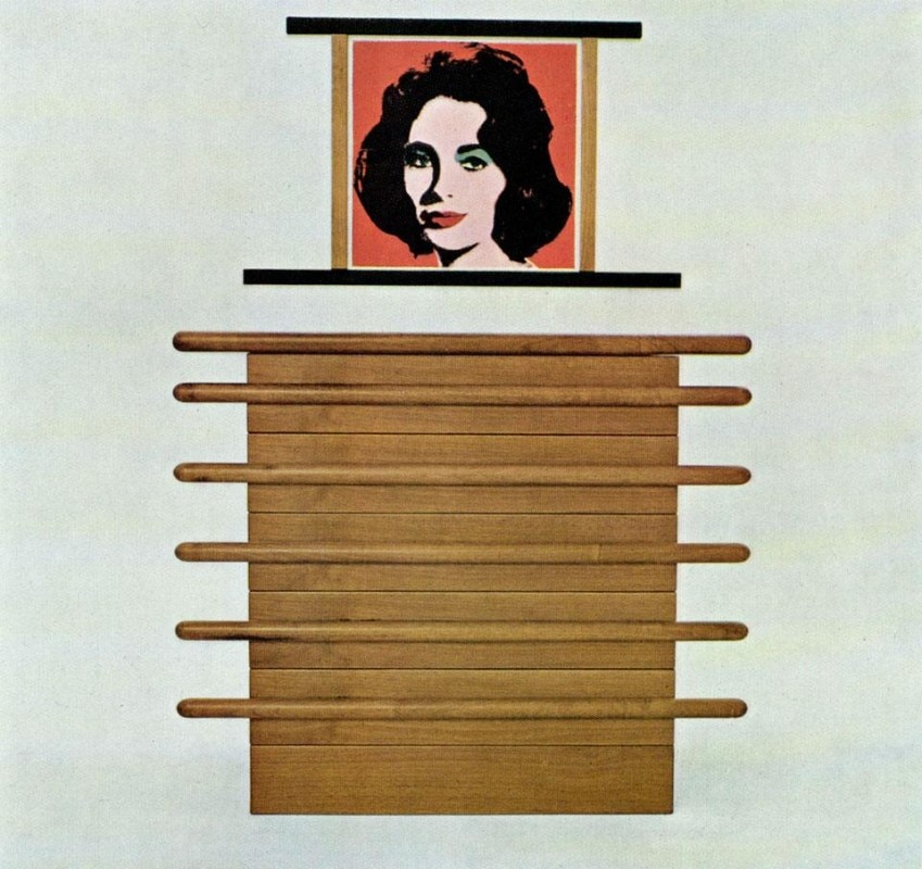 A chest of drawers for the bedroom in natural walnut; on the wall, a lithograph by Andy Warhol.