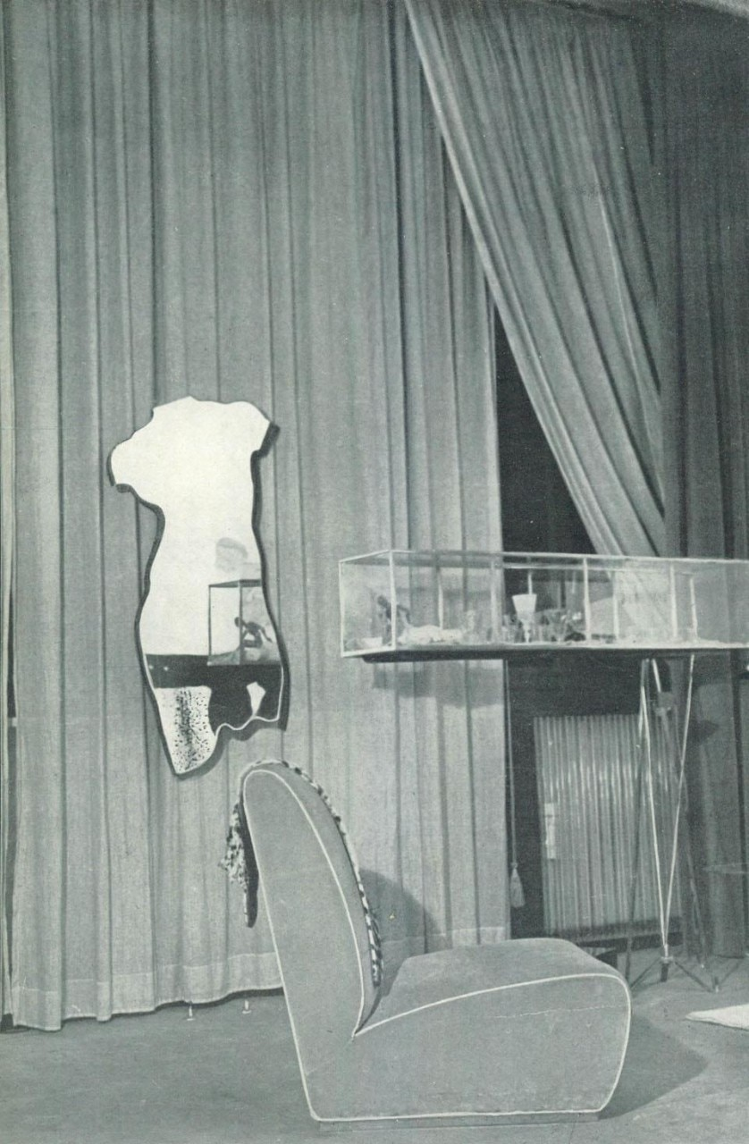 The 'Venus' mirror,  lounge chair and window.