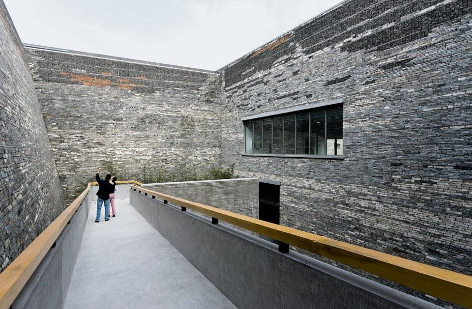 A series of open-air courtyards have been dug out of the inside of the building.