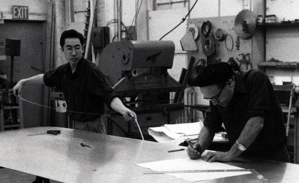 Top: Edison Price, Shoji Sadao, and Buckminster Fuller with parts for MoMA Tensegrity mast, 1959. Courtesy of Fuller and Sadao PC. <br />Above: Isamu Noguchi and Shoji Sadao working on aluminum sculptures at Edison Price's shop, 1958. Photo Courtesy The Noguchi Museum, New York.