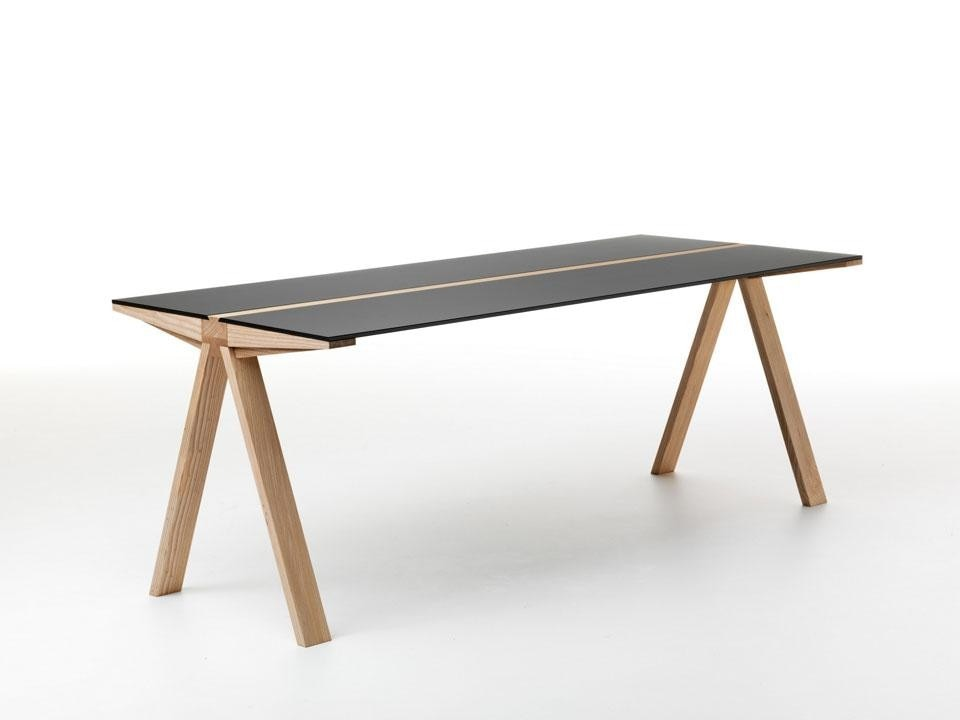 The table is available with glass or wooden tops