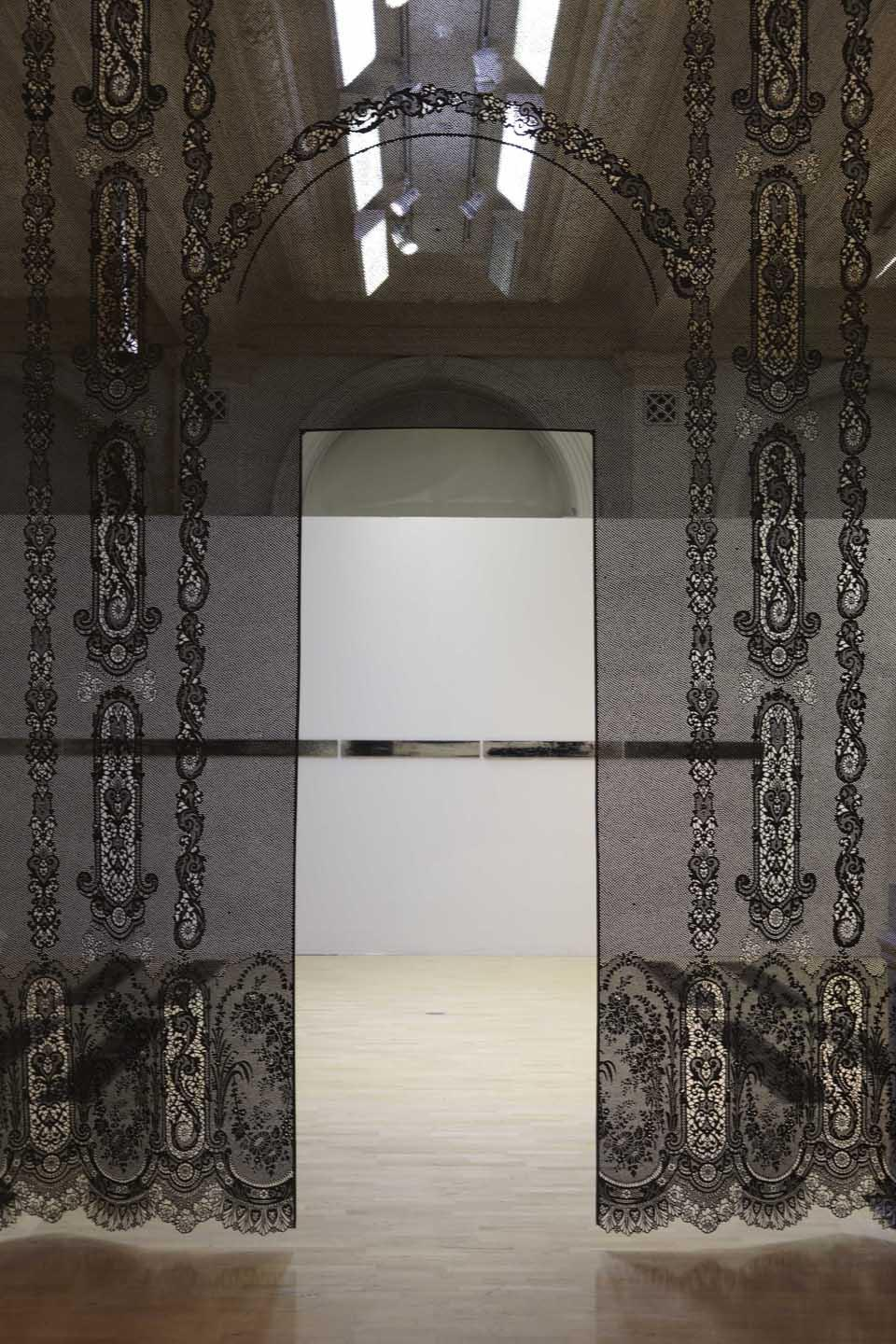 Piper Shepard (USA) has taken a piece of historic point de gaze lace from the BMAG