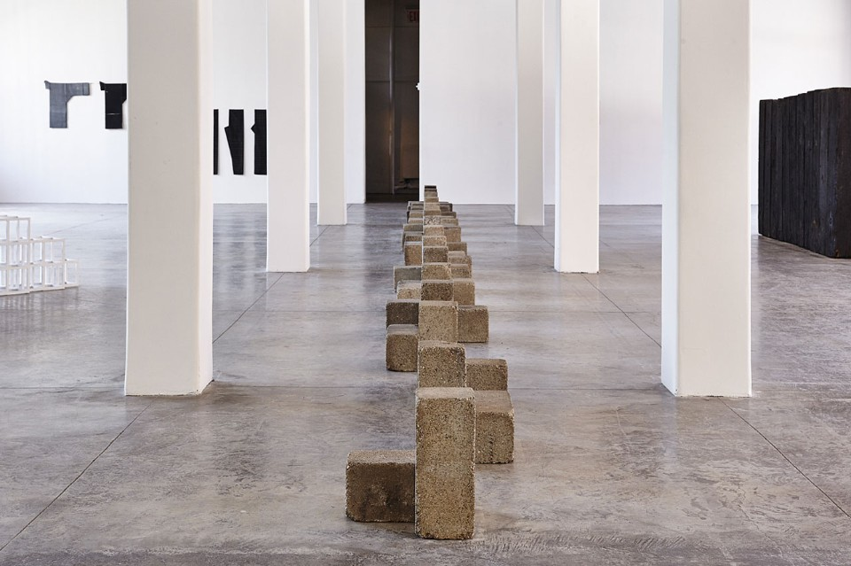 Installation view of Uncarved Blocks by Carl Andre in FORTY. Image courtesy of MoMA PS1. Photo by Pete Deevakul.