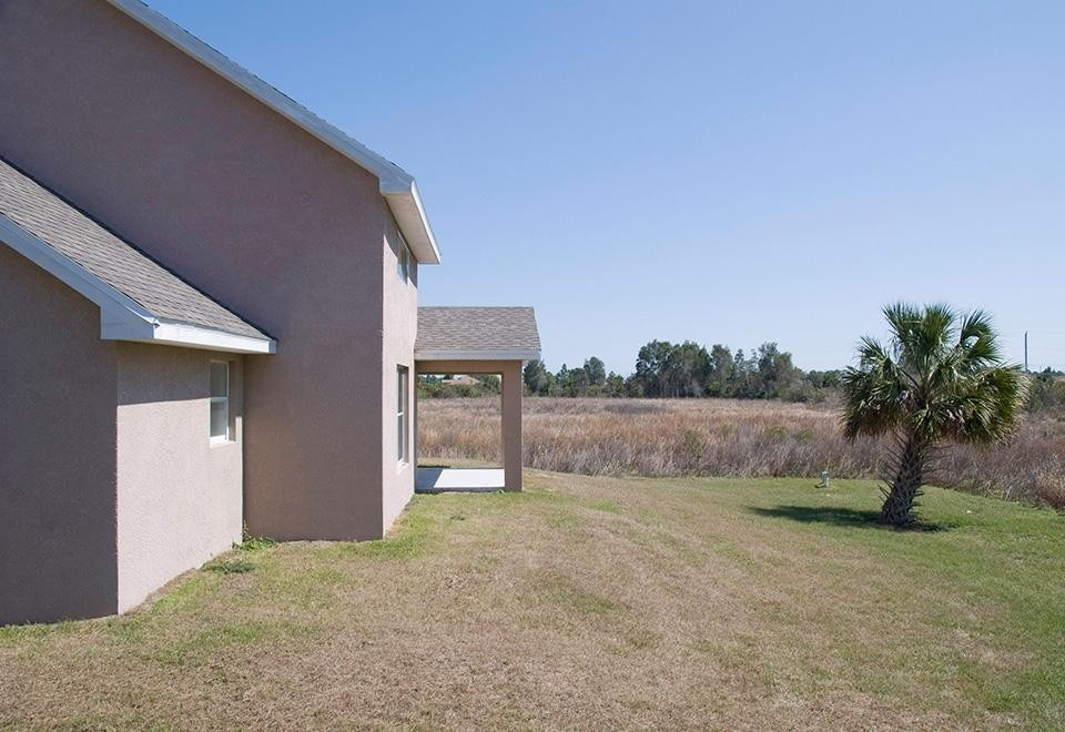 <i>Landscaped Yard, Lehigh Acres, Florida,</i> 2009. © Daniel Kariko.
