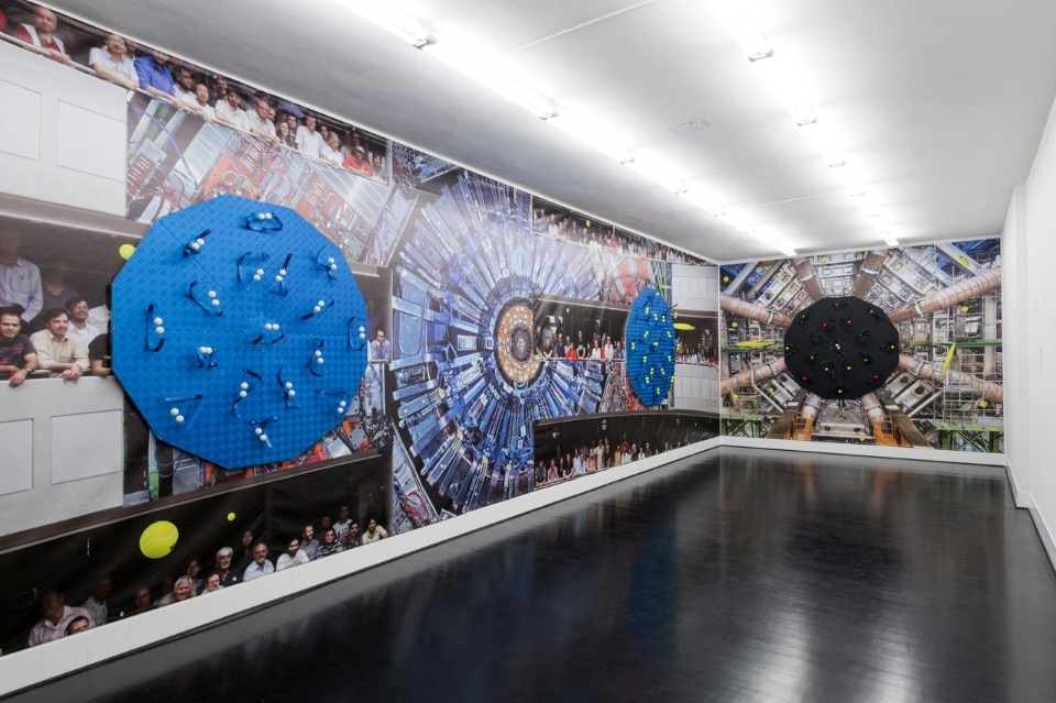 Luca Pozzi, <i>Detectors</i>, 2015. Exhibition view at Spazio 22, FL Gallery : Photo © Cosimo Filippini. Background image ©: CERN (LHC, Atlas Detector) and Michael Hoch (CMS Experiment)