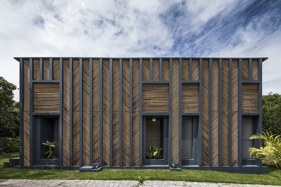 Brazil. A bamboo-clad house made of blue concrete